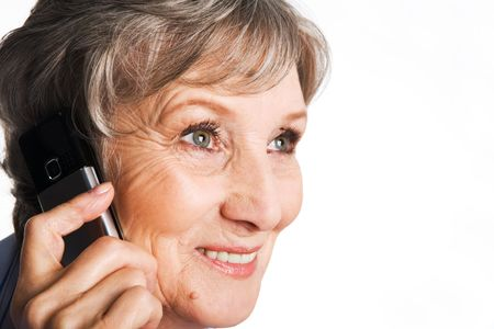 Photo of elderly female speaking on the phone with smile over white background Stock Photo - 4920792