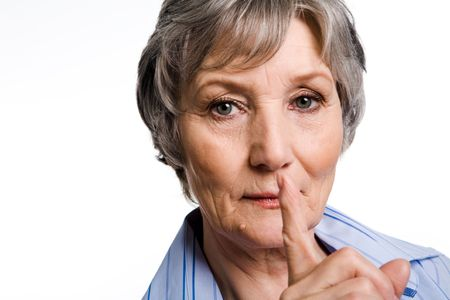 congenial: Photo of elderly female showing gesture of silence over white background Stock Photo