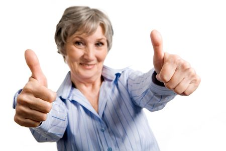 Image of successful aged woman showing thumbs up and looking at camera Stock Photo - 4920843