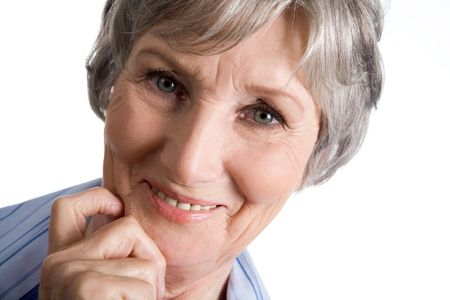 Photo of aged female touching her chin and looking at camera on white background Stock Photo - 4920787