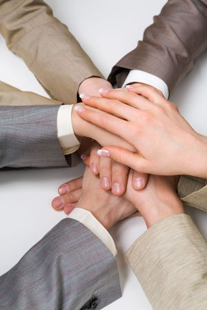 Image of business people hands on top of each other symbolizing support and power Stock Photo - 4921470