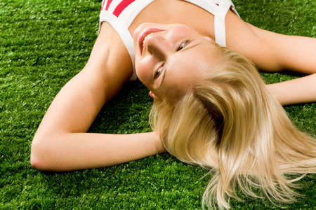 Photo of happy blond female lying on green grass and enjoying summer day Stock Photo - 4941350