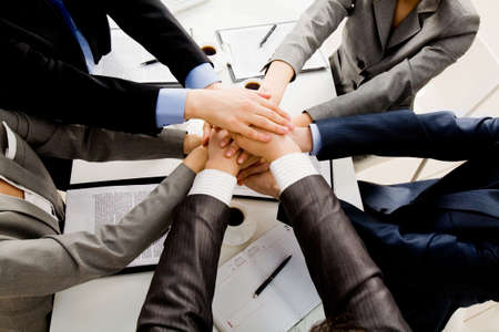 Image of business people hands on top of each other symbolizing support and power Stock Photo - 4935797