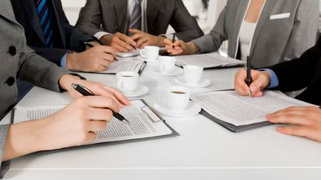 ballpoints: Image of business people hands with ballpoints writing on papers while planning work