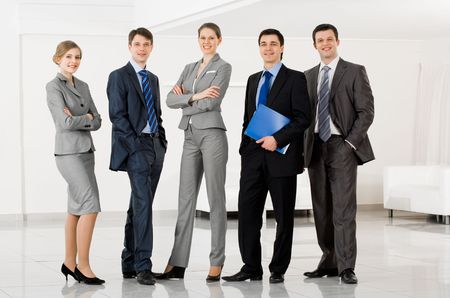floor standing: Portrait of confident business group standing in row and looking at camera