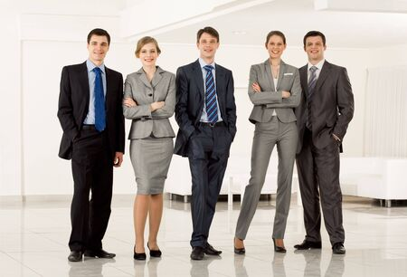 people in a row: Portrait of confident business group standing in row and looking at camera