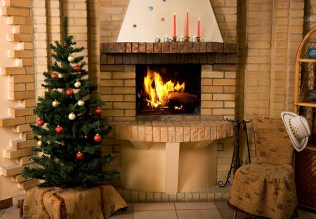 fire place: Photo of interior of room prepared for celebrating Christmas day