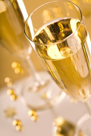 Close-up of flute of champagne over golden background Stock Photo - 6075154