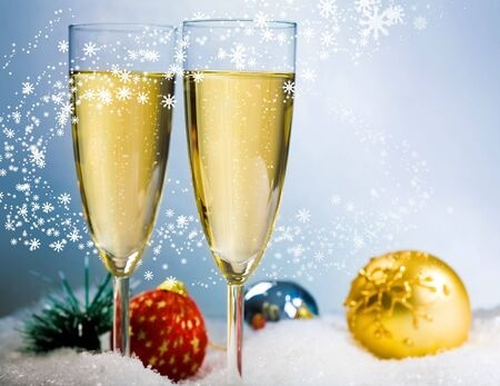 Image of two flutes with champagne in snow photo