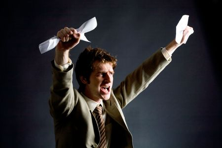 Photo of emotional businessman with papers raising his arms Stock Photo - 6091651