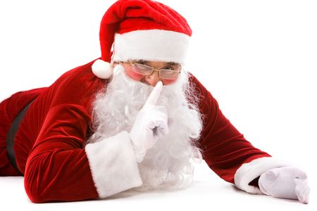 secrets: Portrait of Santa showing sign of silence over white background