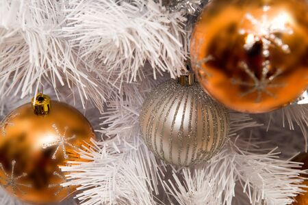 Close-up of toy balls hanging on white fluffy branch of artificial fir tree Stock Photo - 6091862