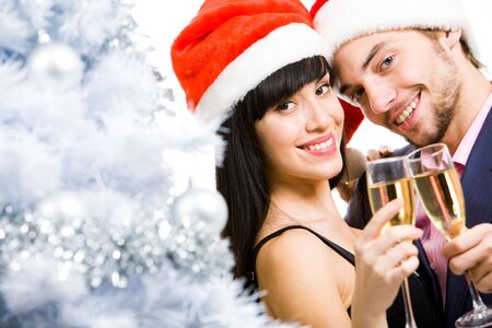 Portrait of happy couple with champagne looking at camera and smiling Stock Photo - 6091851