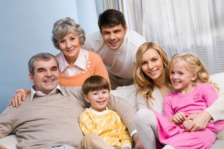 Portrait of senior and young couples with their children looking at camera at home Stock Photo - 6091829