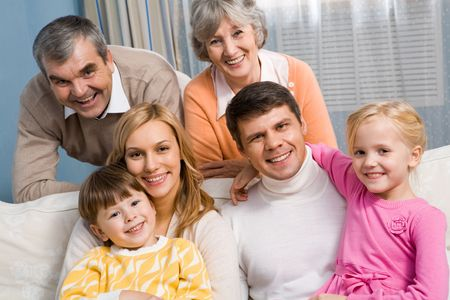 Portrait of senior and young couples with their children looking at camera at home Stock Photo - 6091847
