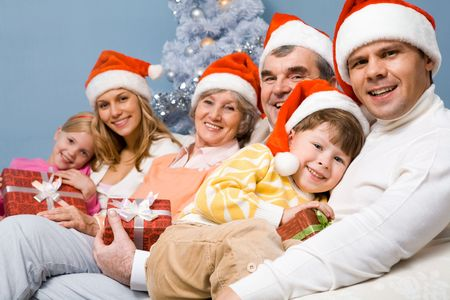 Portrait of happy family in Santa caps on Christmas Eve Stock Photo - 6091843