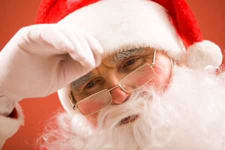 Photo of tired Santa Claus over white background photo