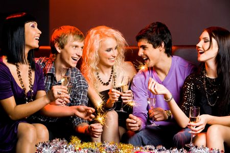 Portrait of joyful friends toasting with flutes of champagne at party Stock Photo - 6107026