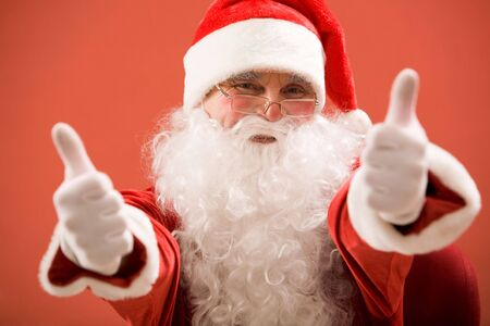 Photo of happy Santa Claus showing both thumbs up and looking at camera Stock Photo - 6106981