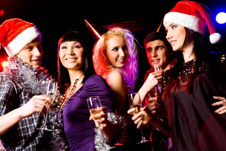 Portrait of modern young people enjoying themselves at New Year party photo