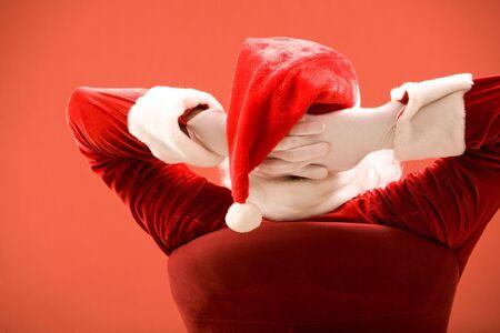 Back view of Santa Claus keeping his hands behind head Stock Photo - 6106984