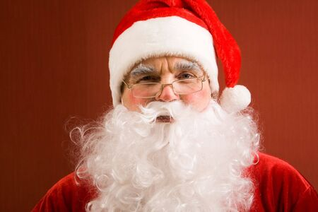 Photo of happy Santa Claus in eyeglasses looking at camera Stock Photo - 6106994