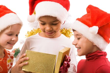 Happy children looking into giftbox with smiles photo