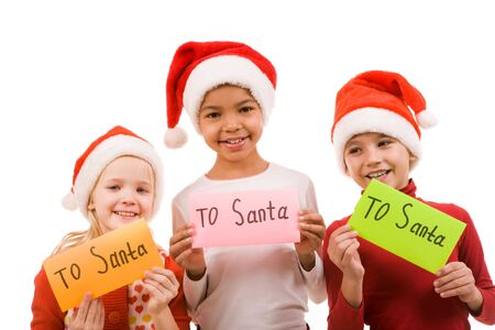 Happy children holding small papers with note �To Santa� photo