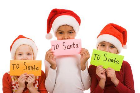 Happy children holding envelopes with note �To Santa� photo