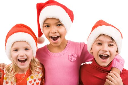 santa girl: Photo of happy friends in Santa caps laughing over white background Stock Photo