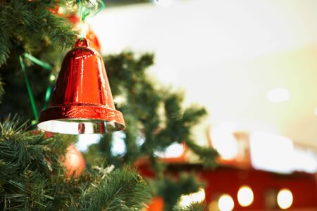 Close-up of red toy bell hanging on green spruce branch Stock Photo - 6109318