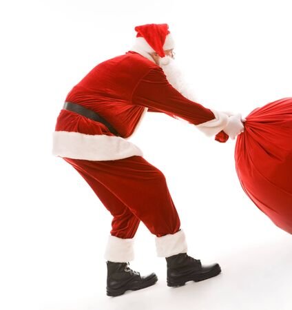 christmastime: Portrait of smart Santa carrying heavy big red sack with presents