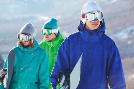 Portrait of handsome snowboarder in googles on background of his friends Stock Photo - 6107231