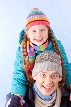 Image of happy man holding his daughter on shoulders Stock Photo - 6107216