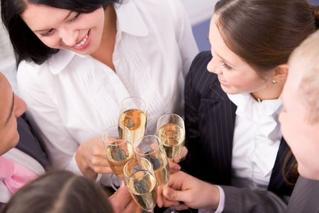 Photo of happy friends holding champagne flutes during party Stock Photo - 6107079