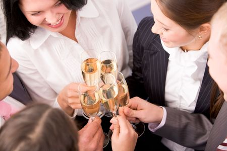 Photo of happy colleagues holding champagne flutes at corporate party photo