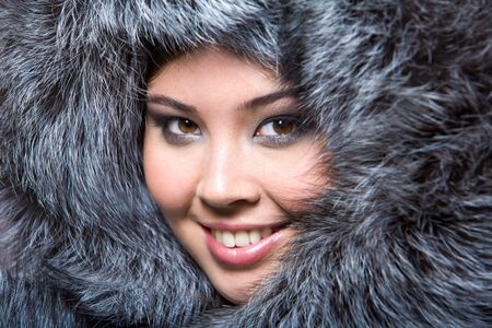 Face of pretty woman wearing luxurious furs photo