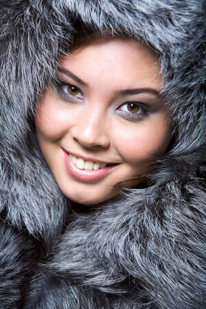 Face of pretty woman wearing luxurious furs Stock Photo - 6107274