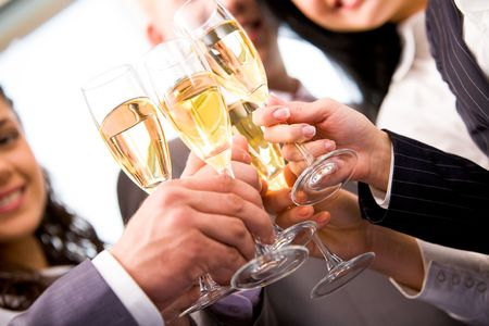 Close-up of friends hands holding glasses with champagne and making cheers Stock Photo - 6107098