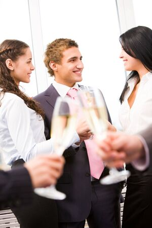 Image of cheering friends interacting at corporate party Stock Photo - 6107172
