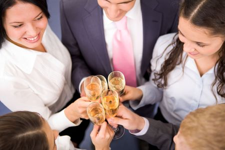 Photo of happy friends making toast during party photo