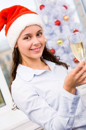 Portrait of beautiful female with champagne looking at camera and smiling Stock Photo - 6107053