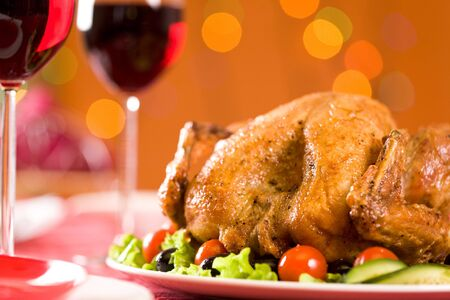 vegs: Image of roasted turkey with vegs and red wine on Christmas table Stock Photo
