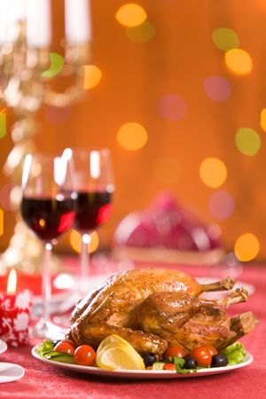 roasted chicken: Image of roasted turkey with vegs and red wine on Christmas table Stock Photo