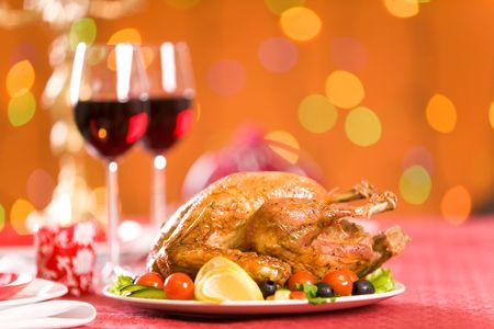 veggie tray: Image of roasted turkey with vegs and red wine on Christmas table Stock Photo