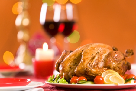 veggie tray: Image of roasted turkey surrounded by vegs on festive table