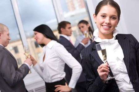 special event: Portrait of pretty girl with champagne flute looking at camera and smiling Stock Photo