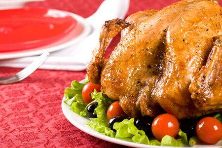 vegs: Image of roasted turkey surrounded by vegs on festive table