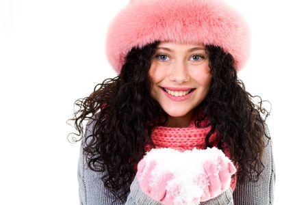 Portrait of happy girl in pink winter fur cap holding snow in hands Stock Photo - 6118976