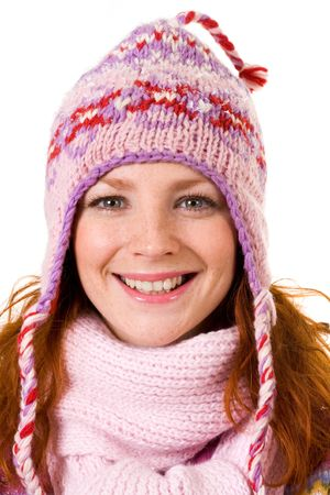 Face of pretty girl in knitted winter cap smiling at camera photo